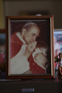 Venerable Pope Paul VI kissing Susan Abbott's son on the head at a general audience