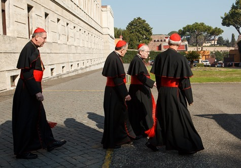 Cardinals Roger Mahony, Daniel DiNardo, Justin Rigali and Donald Wuerl leave the Pontifical North American College in Rome on their way to a final meeting with Pope Benedict XVI February 28, 2013. Pilot photo/Gregory L. Tracy