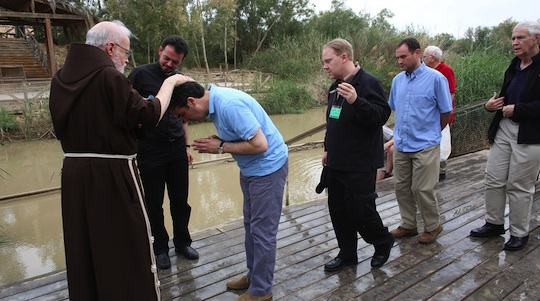 Cardinal Seán renewed the baptismal vows of Fr. Joseph Mazzone and others at the Jordan River. (George Martell/TheGoodCatholicLife.com)